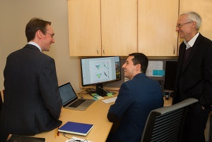 Moussa Zouache, PhD, center, talks with fellow SCTM collaborators, Tiarnan Keenan, MD, PhD, left, and Philip Luthert, MBBS, FRCP, FRCPath, FRCOphth.
